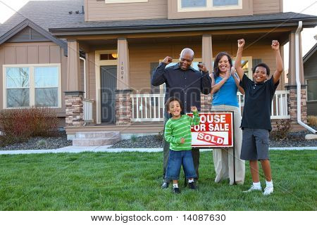 African American family celebrates new home purchase