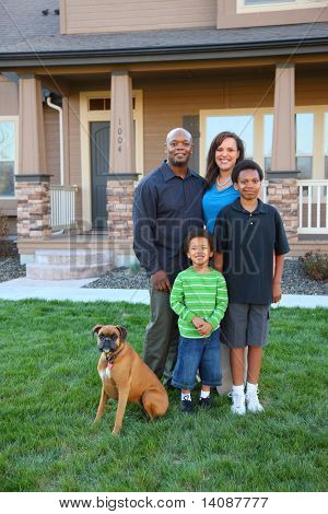 Family and dog in front of home