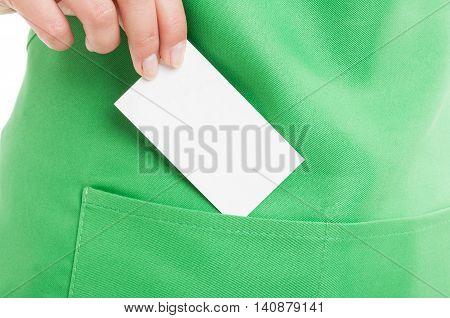 Business Clerk Holding Visit Card Over Apron Pocket