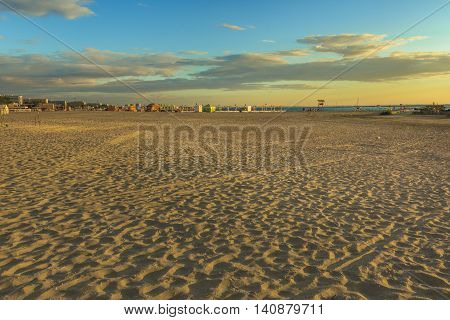 Sunrise in Mamaia. Mamaia is the largest and best known resort on Romanian Riviera. It's situated on 8 km long and 300 m wide sandy land strip at the Black Sea.