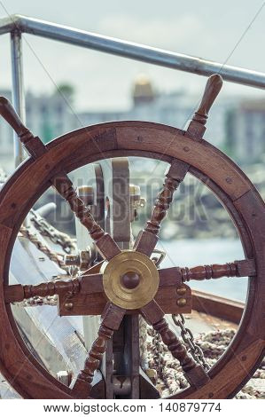 Wooden steering wheel. Steering wheel of the ship