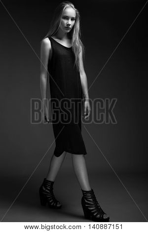 Fashion Model With Long Hair, Beautiful Eyes, Perfect Skin Is Posing In Studio For Glamour Test Phot