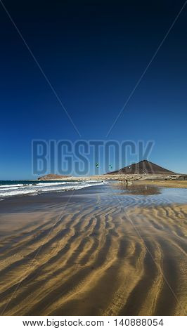 la tejita kite surfing beach and montana roja landmark in south tenerife spain