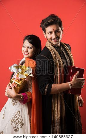 indian brother and sister enjoying and celebrating Raksha Bandhan festival