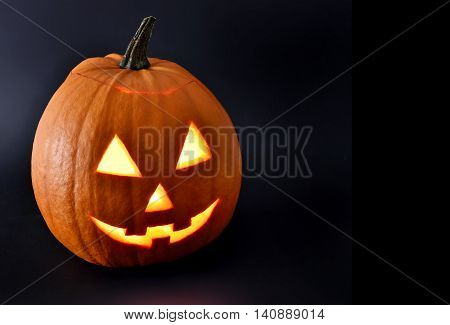 Halloween pumpkin with scary face and black background. Pumpkin, isolated on black background.