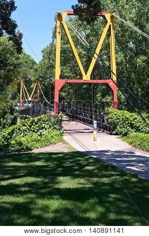 big m suspension footbridge spanning railroad tracks on university of minnesota campus in dinkytown