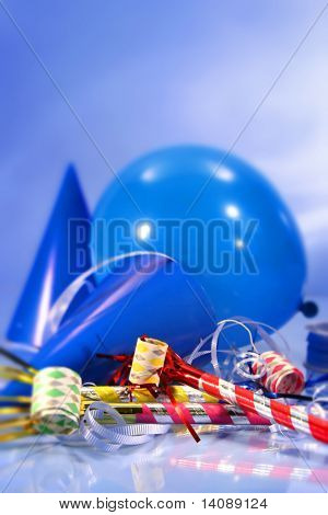 Party decorations with hats, ribbons and balloons