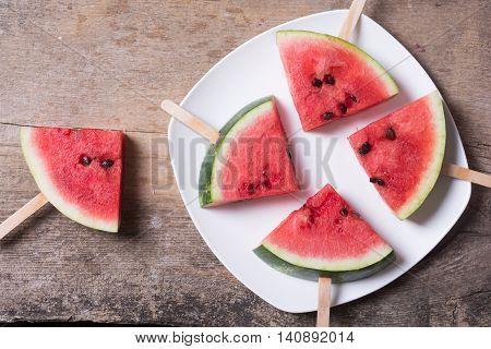 Watermelon popsicle on wooden background . Dessert .