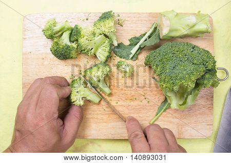 chef cutting broccoli before cooking / cooking steak concept