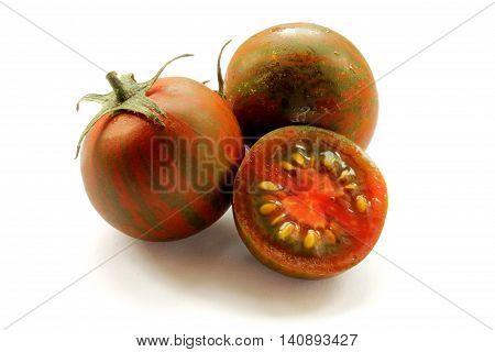 Black kumato tomatoes isolated on a white