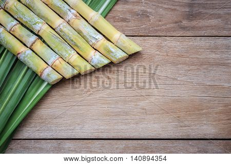 Top View Fresh Sugar Cane And Leaf On Wooden