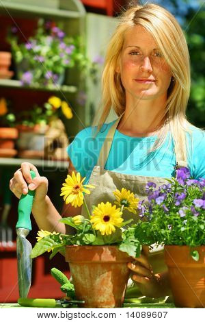 Attractive woman doing work in her garden