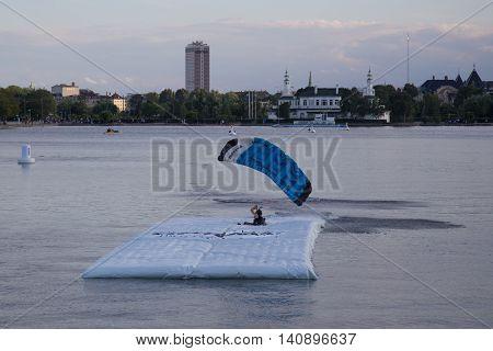 Copenhagen, Denmark - July 30, 2016: A skydiver landing on a pontoon in a lake for the Copenhagen Swoop Challenge.