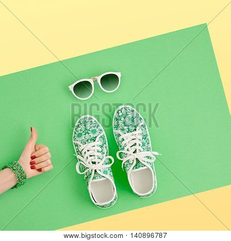 Fashion. Clothes Accessories fashion Set. Female hand YES Gesture and Stylish Trendy gumshoes, Glamor Sunglasses. Summer fashion girl Outfit, accessories. Hipster Essentials. Minimal fashion style