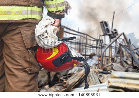 Firefighter Holding Red Safety Helmet Isolated On White