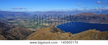 Landscape in Otago New Zealand. Blue Lake Hawea. Mountains and fields. View from Breast Hill.