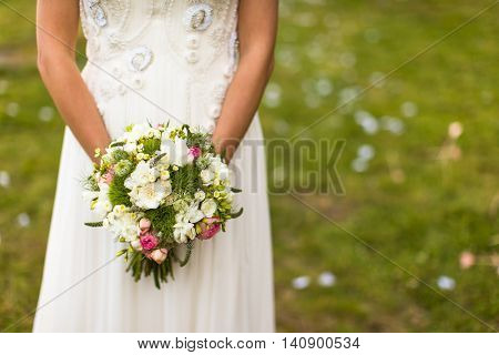 Lovely wedding bouquet in bride's hands