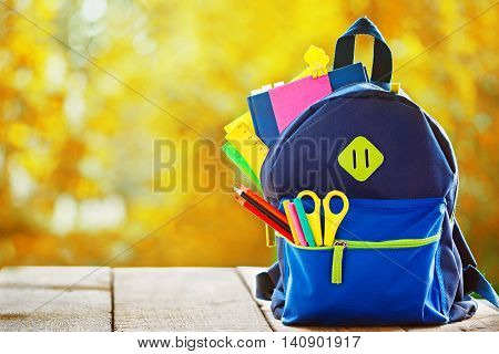 Full School backpack with apple h reautumn nature background