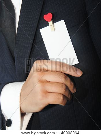 a man holding a namecard with heart