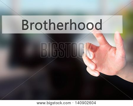 Brotherhood - Hand Pressing A Button On Blurred Background Concept On Visual Screen.