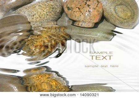 Wet rocks against white background