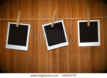 instant photo pictures against wood background