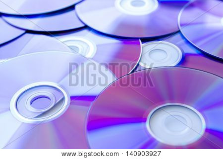 Many Compact Discs scattered seen up close