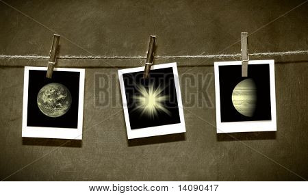 Photo paper attach to rope with clothes spins on grunge  background