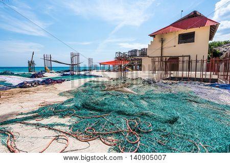 large used green fising nets on the coast of Zanzibar