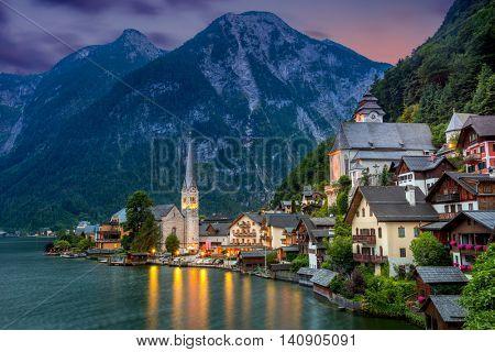 Famous Hallstatt village in Alps and lake at dusk, old architecture, Austria, European travel