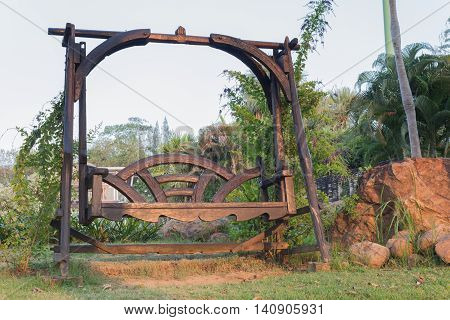 wood swing chair in the nature garden