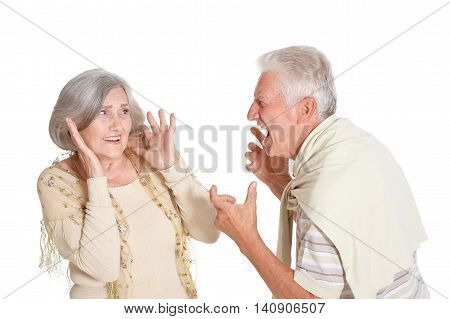 Fighting senior couple on a white background