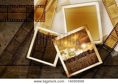Old film and photos on distressed wood background