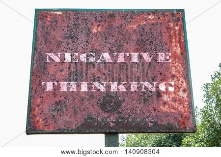 Negative thinking text message on display board.