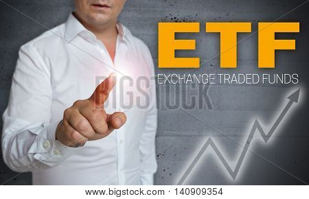 etf touchscreen is operated by man background