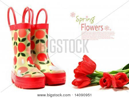 Child's rain boots with tulips on white