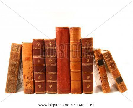 Old antique books against a white background