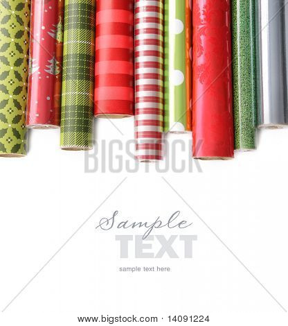 Rolls of colored wrapping  paper on white background