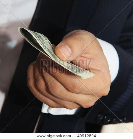 Business men holding money 100 american dollars