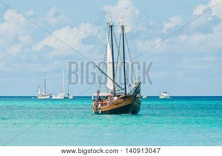 Oranjestad Aruba - December 01 2011: Tourists sailing aboard Jolly Pirates along the coastline and enjoy the beautiful tropical island of Aruba at December 01 2011.