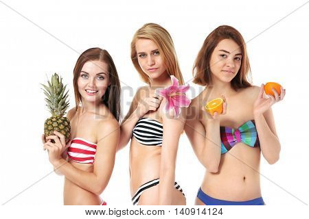 Young women in bathing suits isolated on white