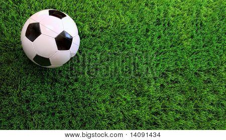 Closeup of soccer ball on green grass