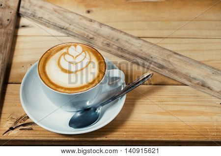 hot fresh coffee in white cup on wooden table and white saucer cappuccino coffee mocha coffee espresso coffee latte coffee top view