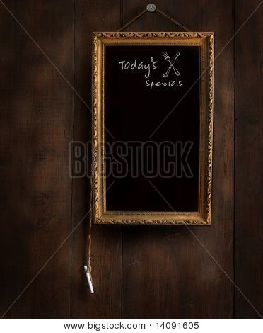 Old chalkboard on wood with copy-space for writing menu
