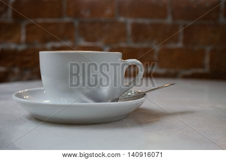 hot fresh coffee in white cup on wooden table brick wall and white saucer coffee bean cappuccino coffee mocha coffee espresso coffee latte coffee