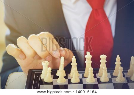 Business Man Moving Chess Figure With Strategy And Team Leadership Thinking