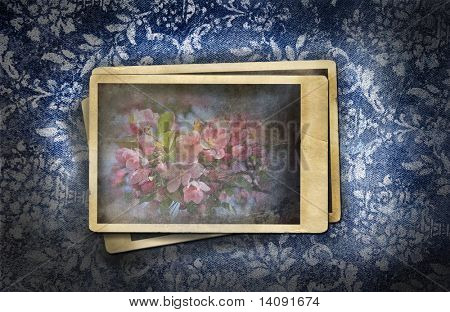Grungy denim with photo on faded floral background