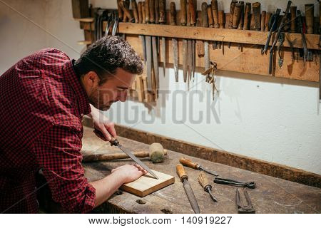 Carpenter Working Hard With Tools In His Carpentry