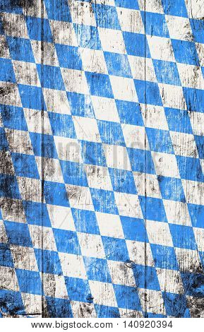 Oktoberfest background with blue and white rhombus pattern. Wooden background. Studio shot.