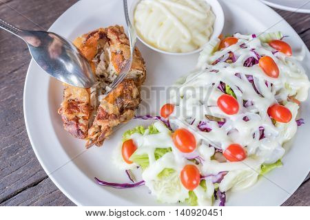 Grilled Soft Shell Crab Salad On White Dish